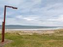 Beach across from the property, feat. a Wild Atlantic Way signpost